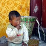 Chinese pick up smoking from an early age. Like this 3-year-old?